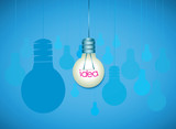Idea concept with hanging light bulbs with glowing one isolated