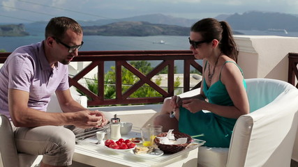 Couple arguing during breakfast on beautiful terrace