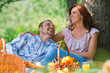 Adult couple picnicking