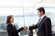 Happy business people shaking hands at the office