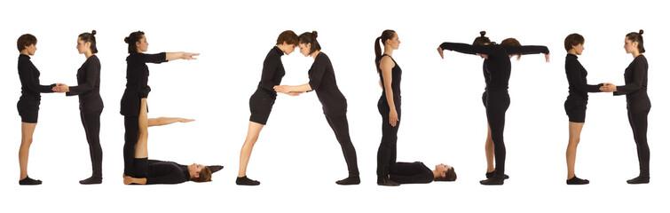 Group of black dressed people standing forming HEALTH word