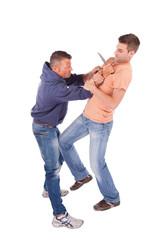 Man defending against knife attack