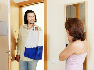 man came to woman with gift