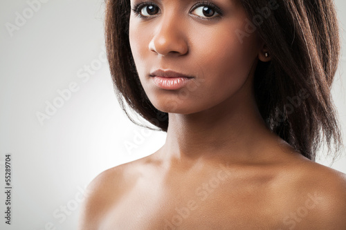 Beautiful woman with her shoulders naked closeup