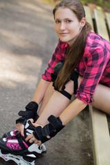 Beautiful girl on rollerblades