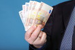 Euro banknotes in male hand