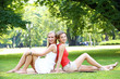 Two girls are having fun in the park