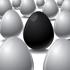 black egg Among white eggs concept