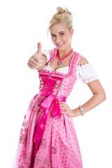 Blondes Mädchen isoliert im rosa Dirndlkleid aus Bayern