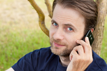 Caucasian man talking on a mobile phone outdoor
