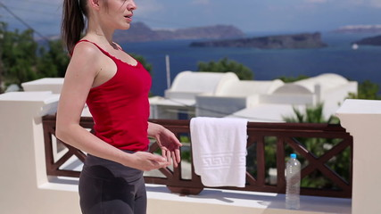 Woman meditating, doing breathing exercise on terrace