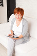 Mature woman with tablet pc
