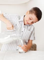 Child with glass pitcher milk