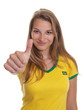 Young brazilian soccer fan showing thumb
