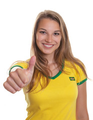 Smiling brazilian soccer supporter showing thump up