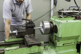 Operator using a horizontal mill machine to cut metallic parts