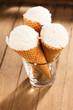 canvas print picture - drei vanille eiscreme waffeln stehend in einem glass