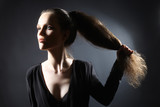 Young fashion model with ponytail poster