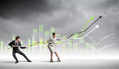 Businesspeople pulling graph