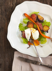 Roasted-vegetable salad with poached eggs