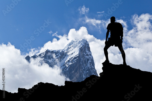 Hiker silhouette, man and mountains