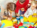Fototapety Child painting at art school.