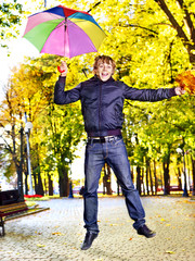 Man holding  autumn umbrella.