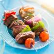 grilled beef shishkabobs on table