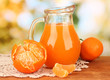 Full jug of tangerine juice,
