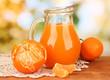 Full jug of tangerine juice,