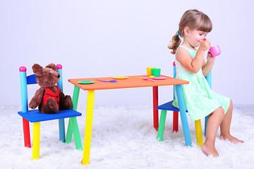 Little cute girl sitting