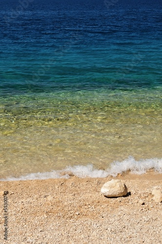 Beautiful beach with big stone in right bottom side of photo