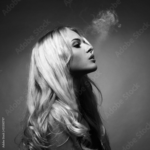 Beautiful lady smokes