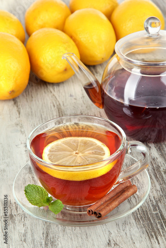 Cup of tea with lemon on table close-up