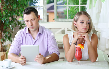 Young couple  taking  with tablet in restaurant