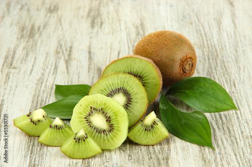 Ripe kiwi on wooden table close-up