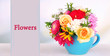 Beautiful bouquet of bright flowers in blue mug