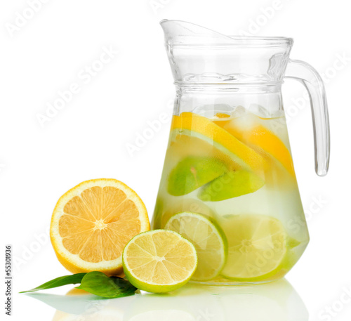 Cold water with lime, lemon and ice in pitcher isolated on