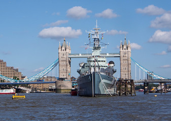 Thames with battleship and Tower Bridge