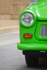 head light of a East-German plastic vintage car. Green Trabant