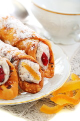 Cannoli and candied oranges.