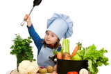 Cute little girl cooking soup with lots of different vegetables