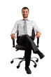 man sitting on office chair and smiling