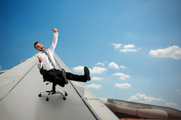 man sitting on chair and flying