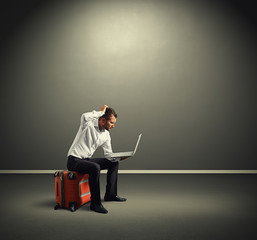 man with laptop and suitcase
