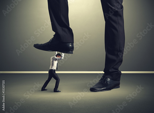 man under big leg his boss