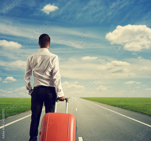 man with suitcase ready for vacation