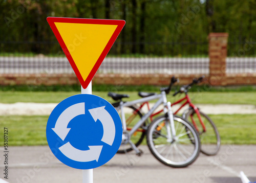 A road sign with bicycles