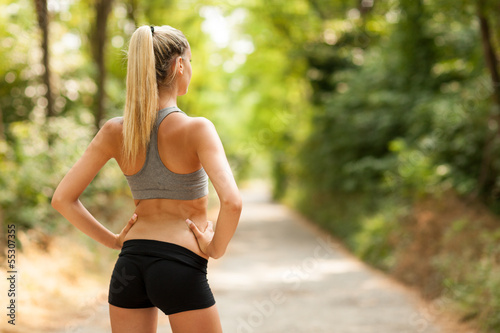 Sexy female with tonic bottom looking at running path