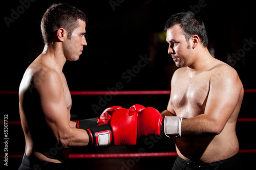A couple of boxers bumping fists before a fight